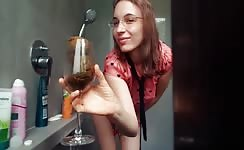 She shits in a wine glass