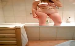 Hot college girl peeing in bathtub