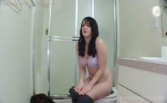 Beautiful brunette pooping in toilet