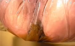 Brunette babe filled plastic panties with shit
