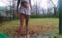 Tattooed babe smears poop outdoor