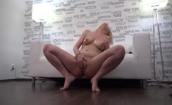 Blonde milf spreads her legs to pee