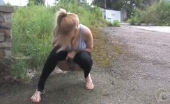 Busty blonde peeing outdoor