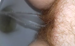 Hairy babe shitting and peeing