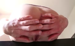 Fingering pussy while shitting a big one